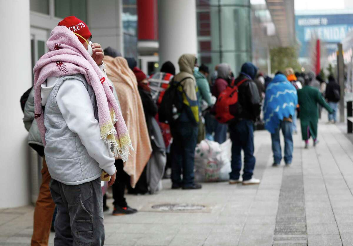 A line of more than 200 people formed outside at the George R. Brown Convention Center, in Houston, Sunday, February 14, 2021, which city officials opened as an emergency shelter for the area homeless, who needed to get out of the freezing temperatures.