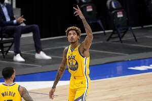 Golden State Warriors' Kelly Oubre Jr. (12) celebrates a 3-point basket during the second half of the team's NBA basketball game against the Dallas Mavericks in Dallas, Thursday, Feb. 4, 2021. (AP Photo/Tony Gutierrez)