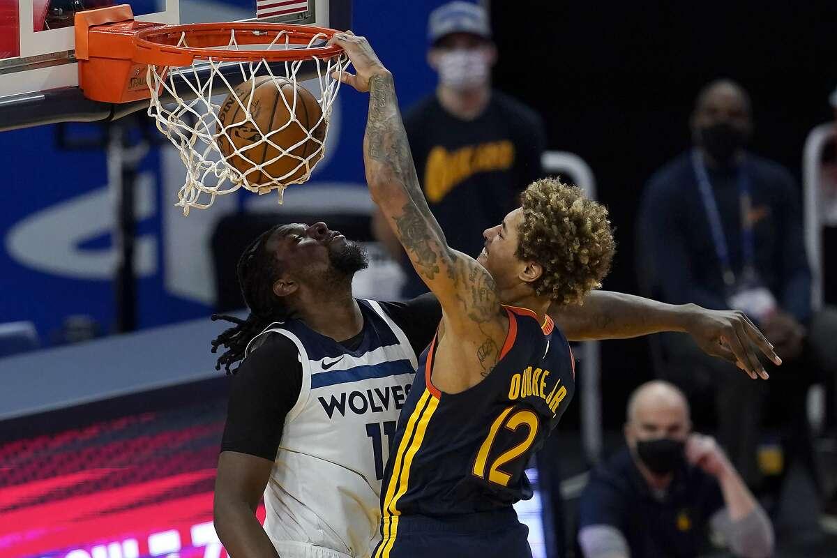 Golden State Warriors guard Kelly Oubre Jr. (12) dunks against Minnesota Timberwolves center Naz Reid during the first half of an NBA basketball game in San Francisco, Wednesday, Jan. 27, 2021. (AP Photo/Jeff Chiu)