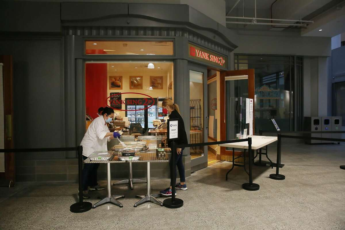 Coco Chan (l to r), assistant and Liana Bravo, manager prepare orders at Yank Sing in the Rincon Center on Thursday, February 11, 2021 in San Francisco, Calif.