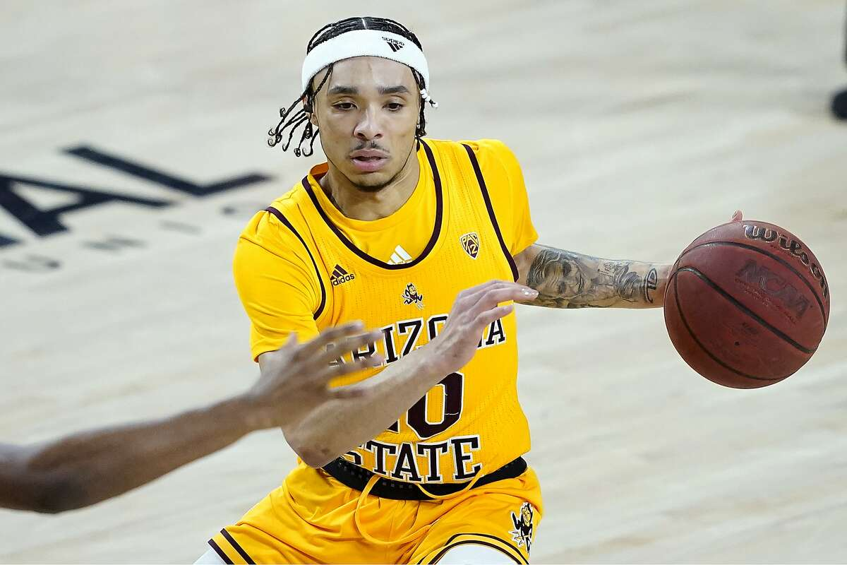 Arizona State guard Jaelen House looks to pass against Oregon State during the second half Sunday in Tempe, Ariz.