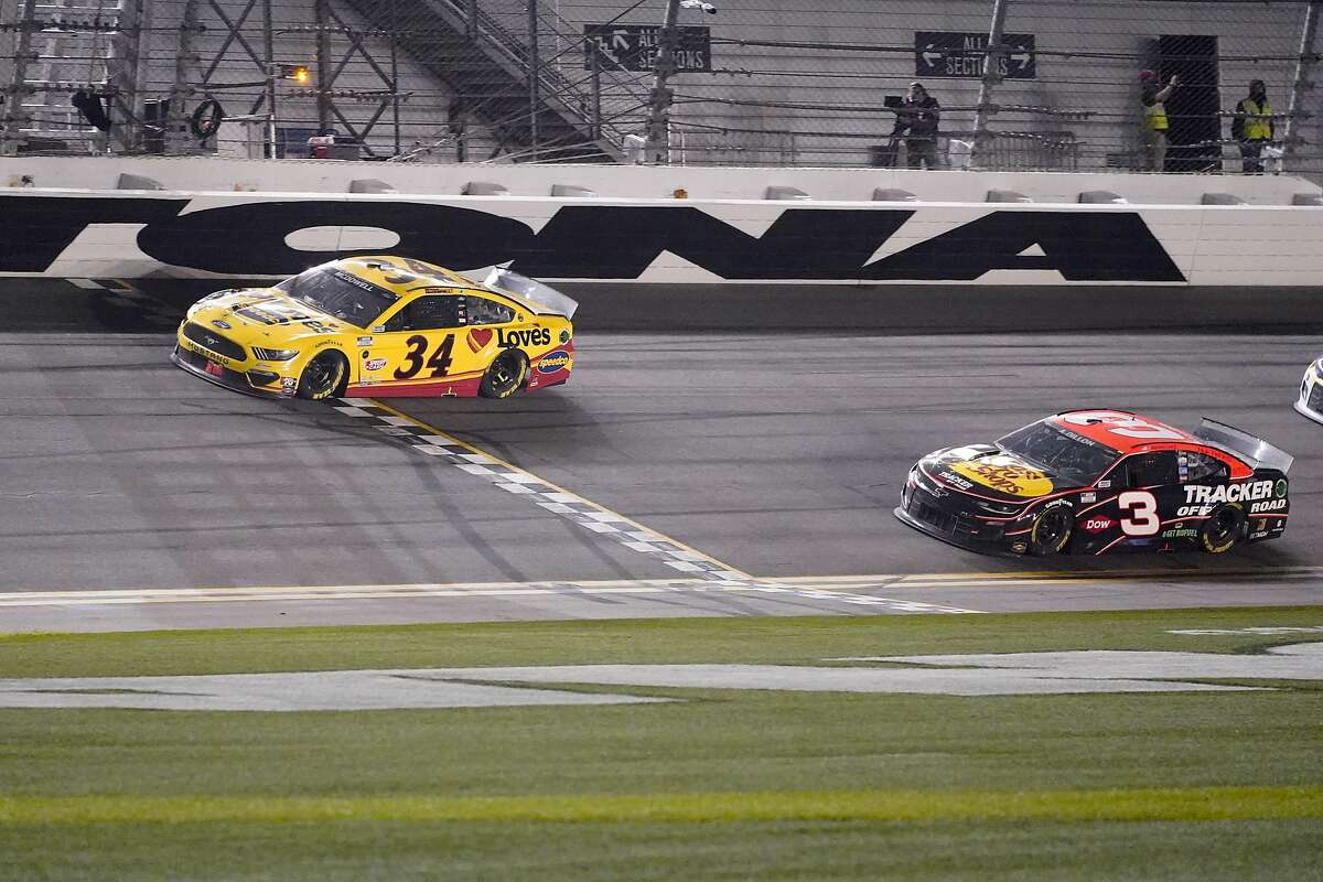 Michael McDowell crosses the finish line ahead of Austin Dillon to win the Daytona 500. It was McDowell's first victory in 358 Cup Series starts.