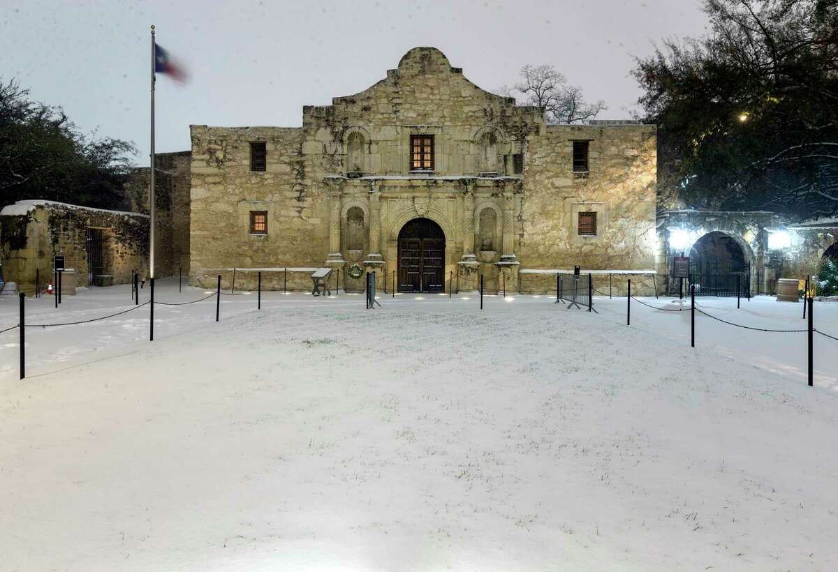 The Alamo is seen early Monday morning, Feb. 15, 2021 behind a layer of snow. The National Weather Service reported Tuesday morning that San Antonio and surrounding areas saw 3-5 inches of snow and some pockets of the forecast area saw 6-7 inches of snow. The Electric Reliability Council of Texas (ERCOT) has also declared the highest level of energy emergency and is requiring rolling blackouts throughout Texas. The National Weather Service reports the areas temperatures are the coldest since 1989.