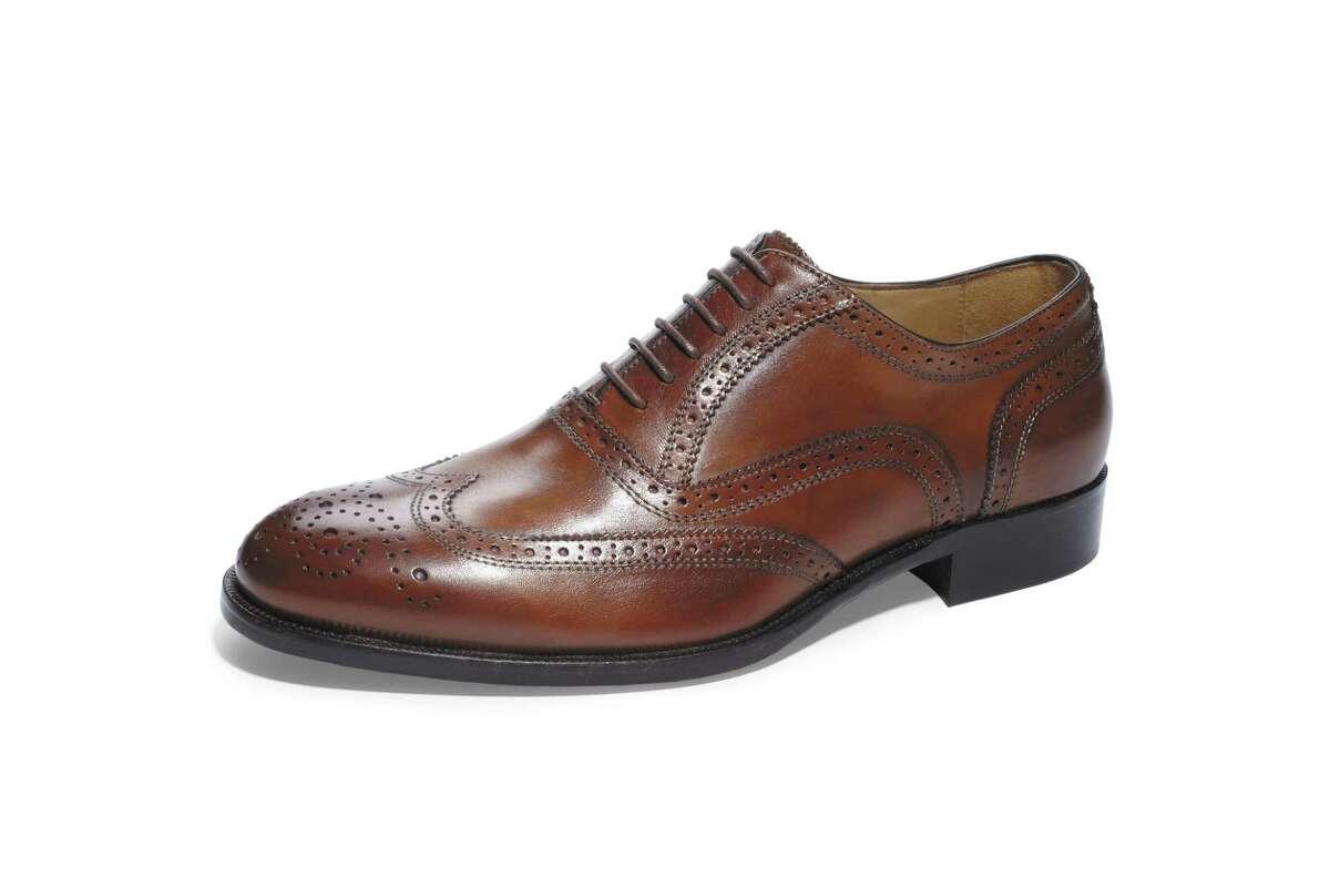 Traditional men's wingtip in dark brown from Saks house label.