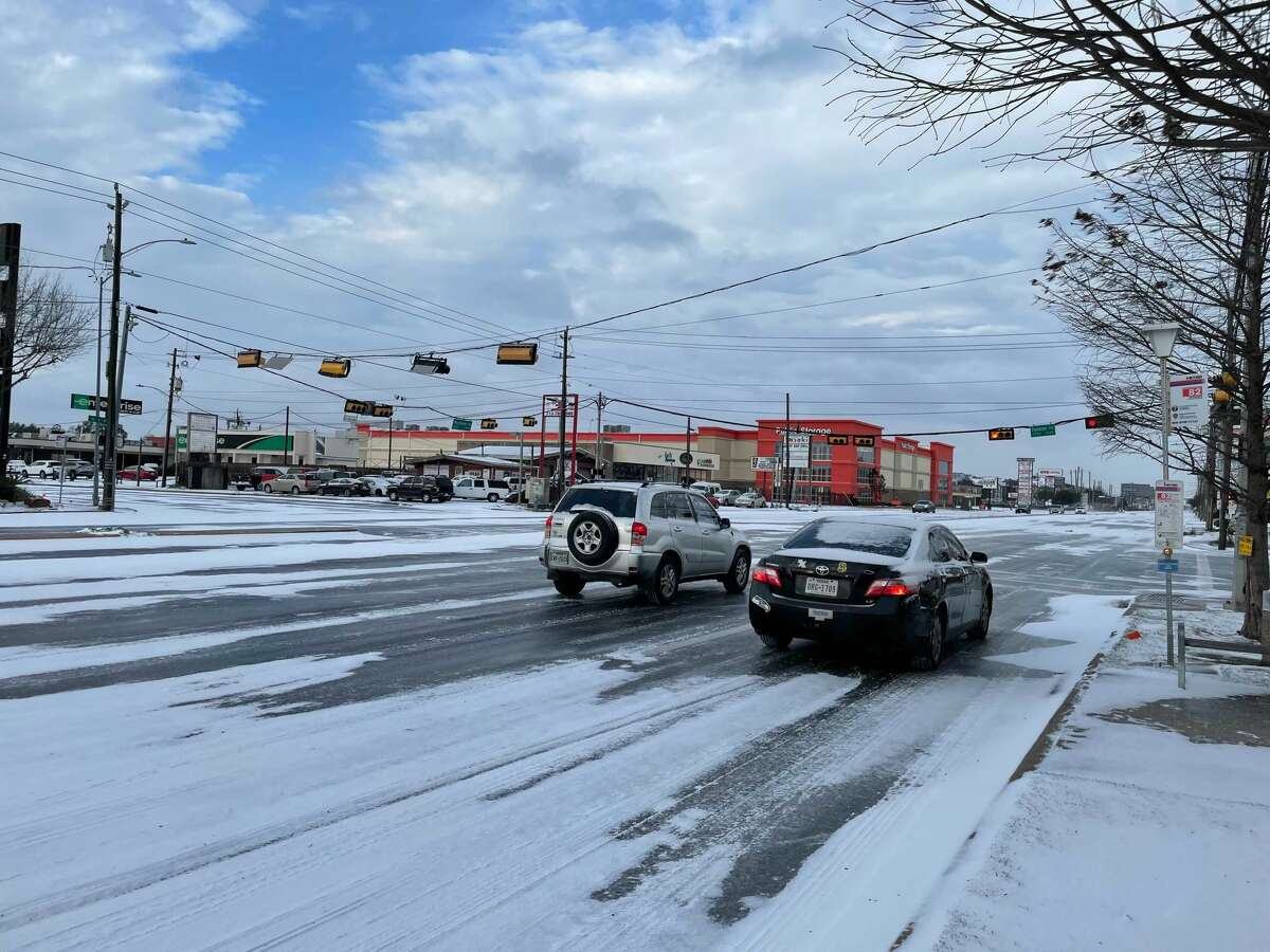 Snow dots Westheimer Road in Houston on Feb. 15, 2021.