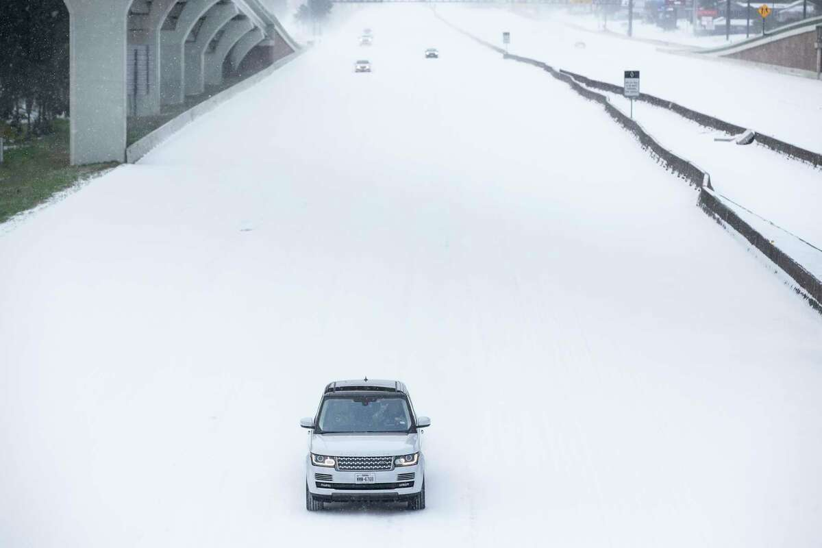 Traffic is sparse on the snow-covered interstate 45 near The Woodlands Parkway following an overnight snowfall Monday in The Woodlands. Temperatures plunged into the teens Monday with light snow and freezing rain.