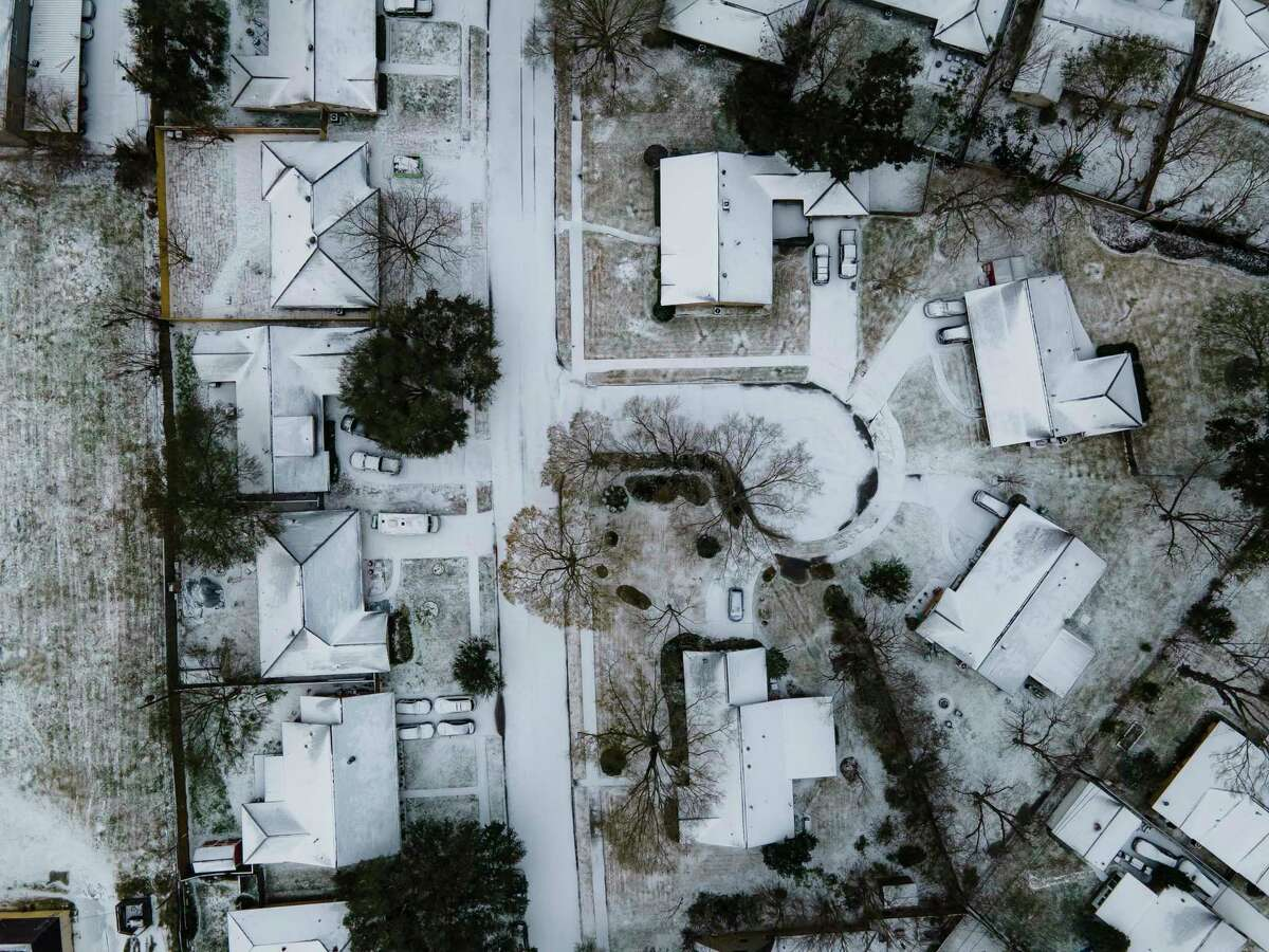 Homes in the Westbury neighborhood are covered in snow along with the rest of Houston, Monday, Feb. 15, 2021, in Houston.