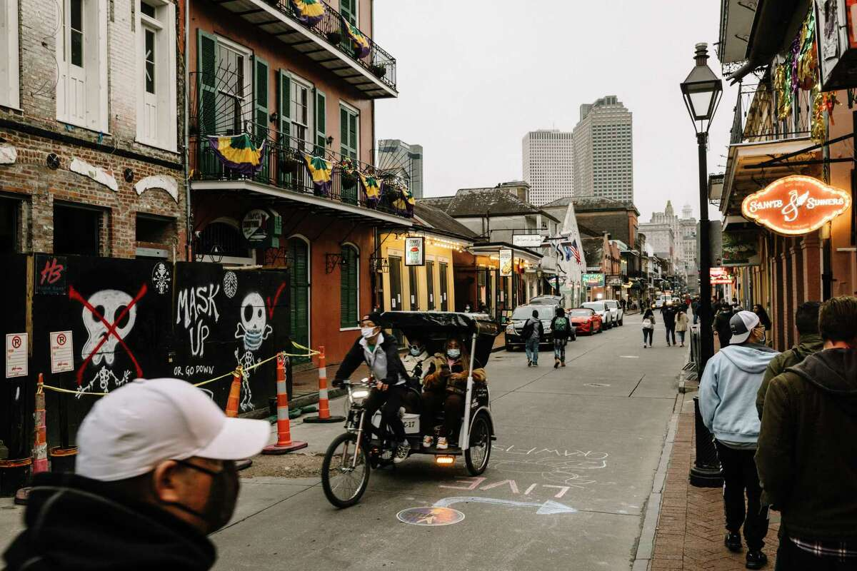 Bourbon Street is quieter than normal as Mardi Gras Day approaches.