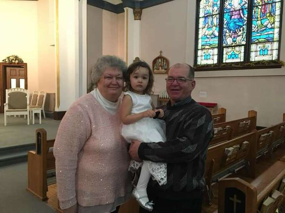 Donald and Charlotte Bredow of Bad Axe have been married 42 years. They are pictured with their granddaughter Ciara. Photo: Tribune File Photo