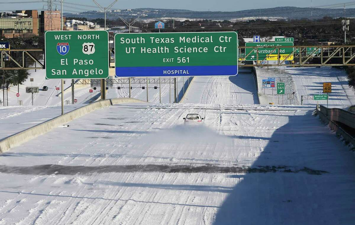A vehicle drives on I-10 westbound on Monday, Feb. 15, 2021. Several inches of snow fell in the city from Sunday, Feb. 14, starting in the evening through the early morning hours of Monday, Feb. 15, 2021. A few vehicles and people were out either to see the spectacle or to try to head to work.