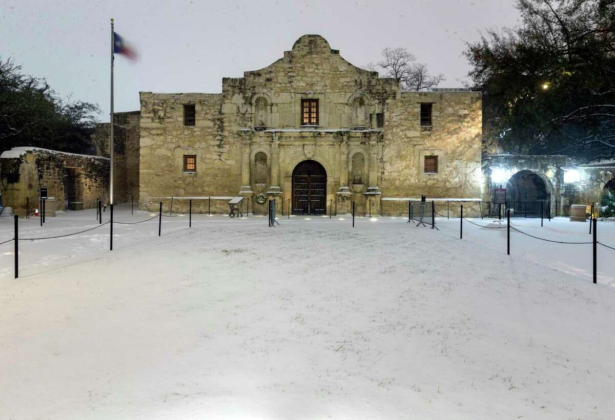 The Alamo is seen early Monday, Feb. 15, 2021, after 3 to 5 inches of snow fell overnight. The Alamo was closed because of the bitter cold and snow.