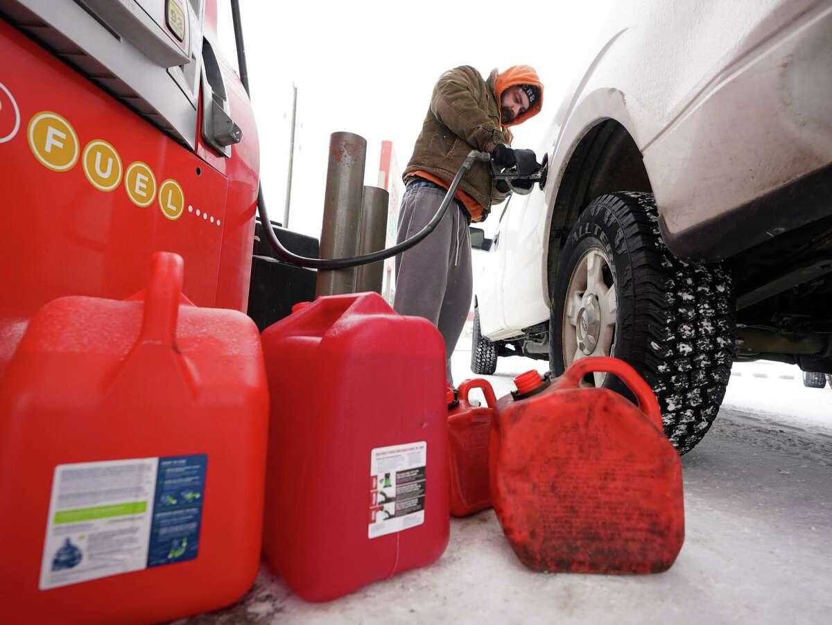 Michael Pence of Tomball fills his truck after filling gas cans at a station along State Highway 249 Monday, February 15, 2021 in Tomball. He said he's having to use a generator after losing power at his home.