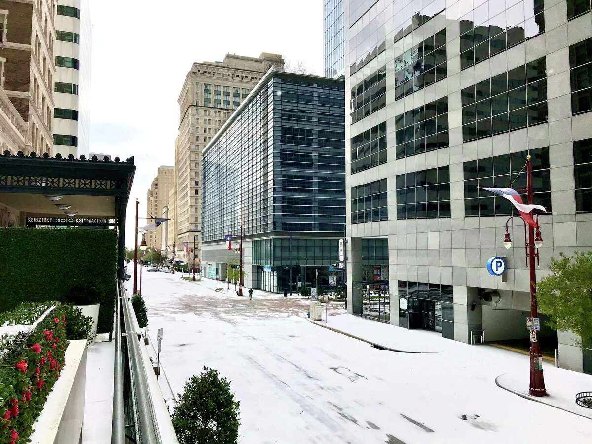 Looking down Texas Avenue from the mezzanine level of the Rice Apartments in downtown Houston on Feb. 15, 2021.
