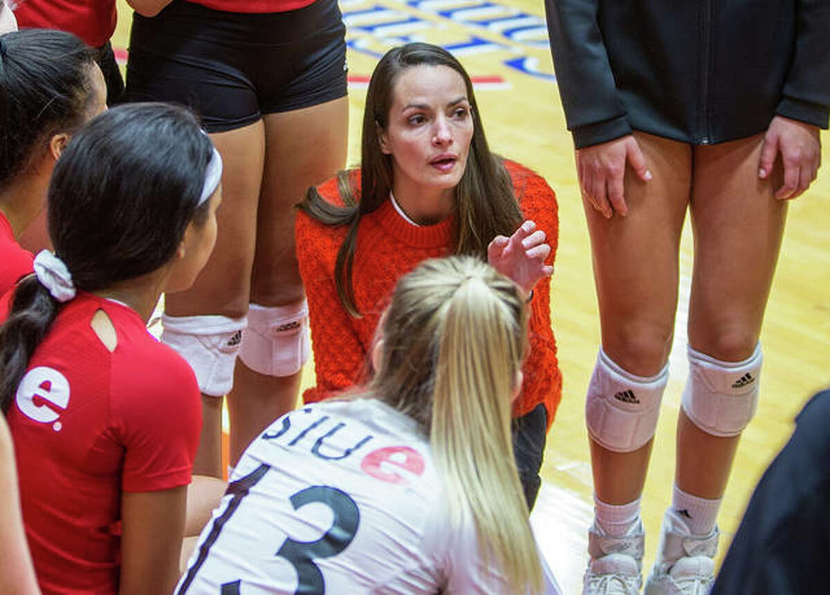 SIUE volleyball coach Kendall Paulus talks with her team last season. The Cougars dropped a 3-1 decision to Jacksonville State Sunday.