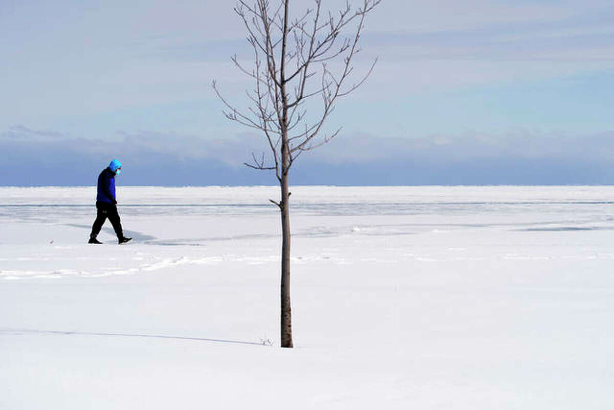 A man walks on a cold winter's day.