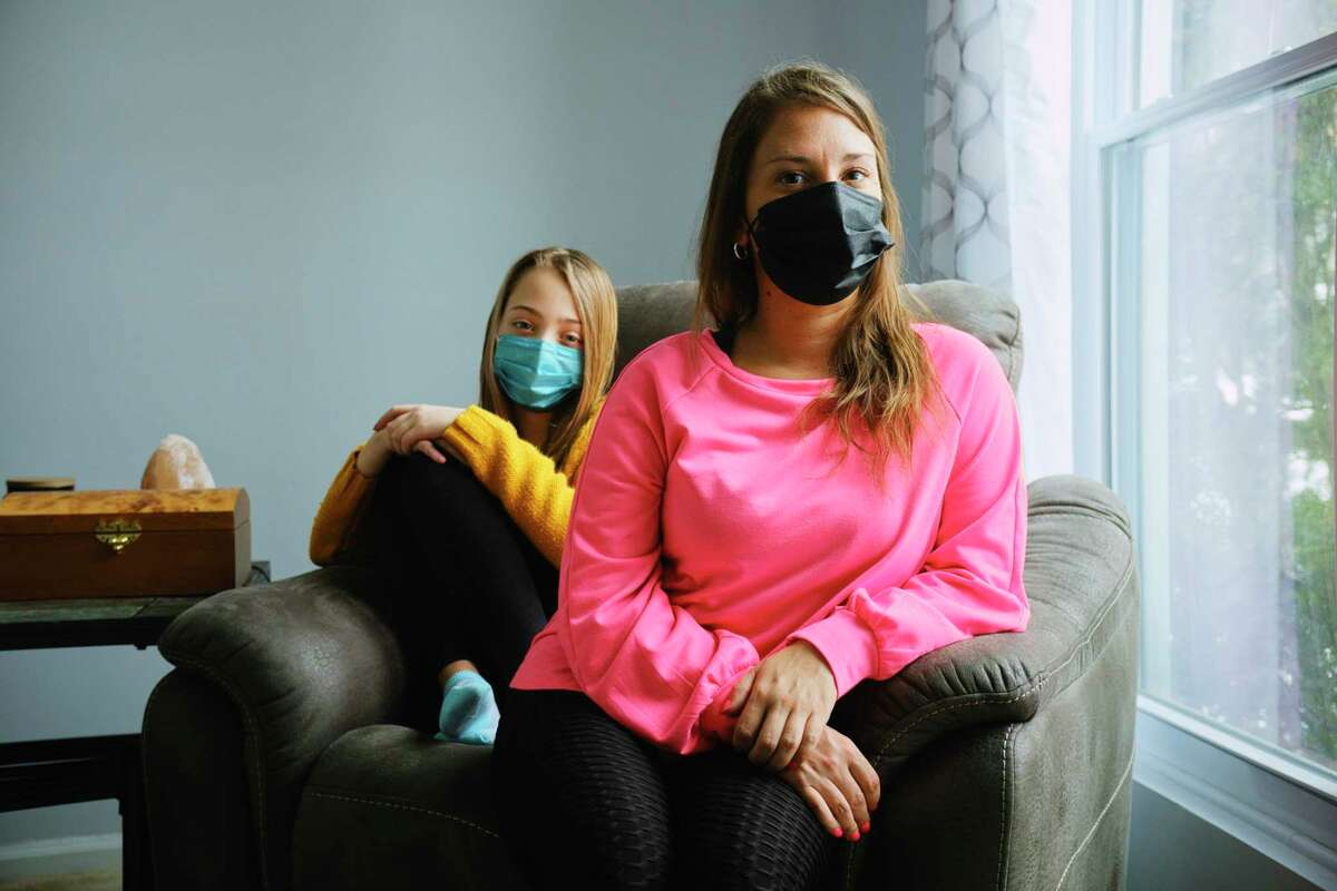 Devon Tarella, with her daughter, Calogera Rose, 12, at her home on Monday, Feb. 15, 2021, in Ballston Spa, N.Y. The YMCA forced Tarella to resign after 12 years of working there because she had to stay home with her daughter during remote schooling. (Paul Buckowski/Times Union)