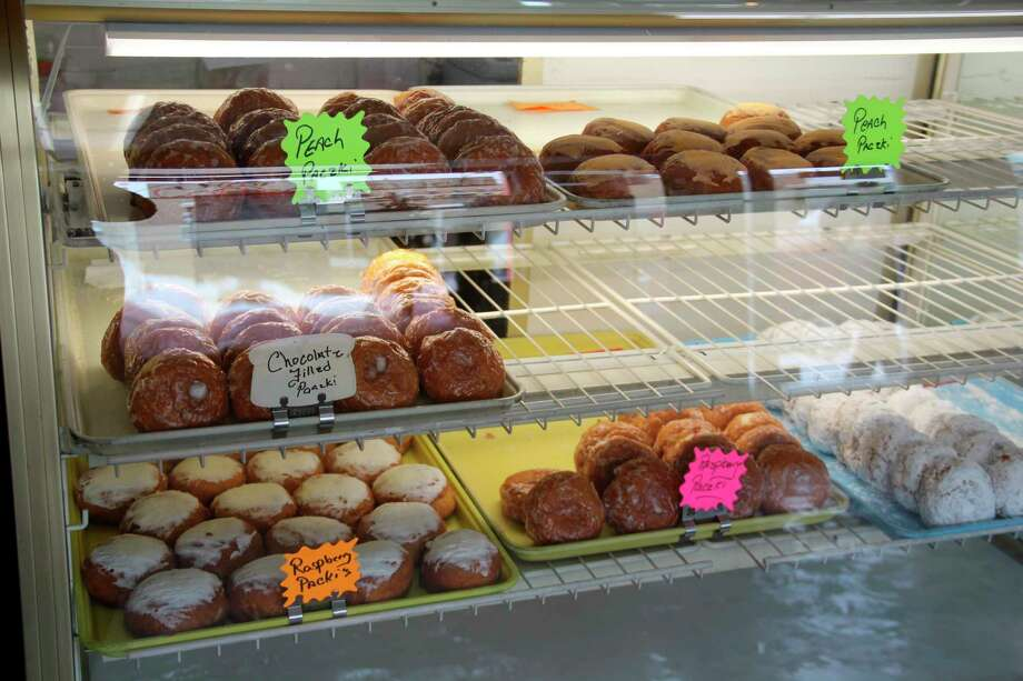 Some of the paczkis on display at Murphy's Bakery in Bad Axe on Monday morning. Murphy's is one of a few places providing paczkis for Fat Tuesday celebrations. (Robert Creenan/Huron Daily Tribune)