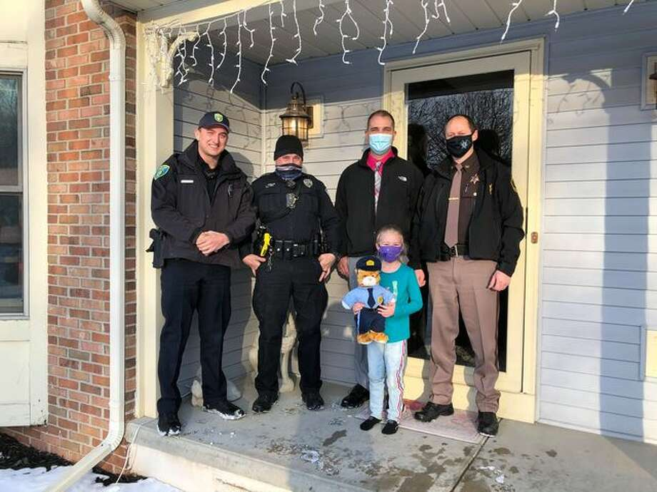 Members of the Midland Police Department made a surprise visit to Joslyn Laundra in celebration of her seventh birthday on Monday, Feb. 15. Photo: Photo Provided/Katie Laundra