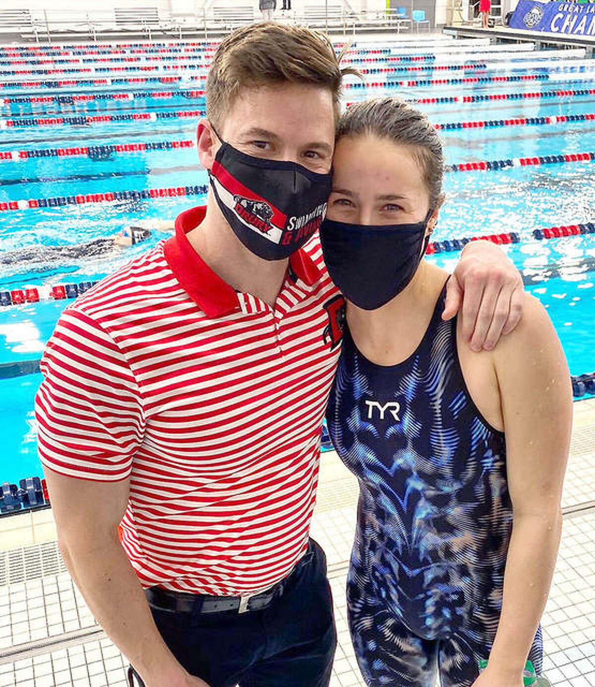 Truman State University senior swimmer Ginny Schranck and her brother Doug, an assistant coach at Drury University, met at Saturday's Great Lakes Valley Conference Swim Meet in Elkhart, Ind.
