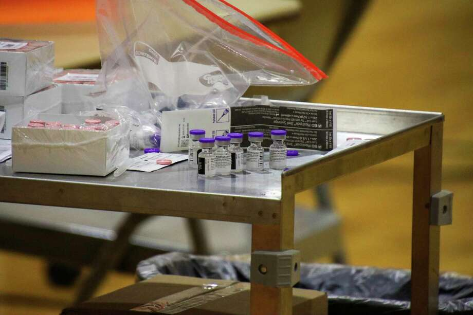 A portable cart holds hundreds of coronavirus vaccines waiting to be administered during a mass clinic in Huron County in January. (Scott Nunn/Tribune File)