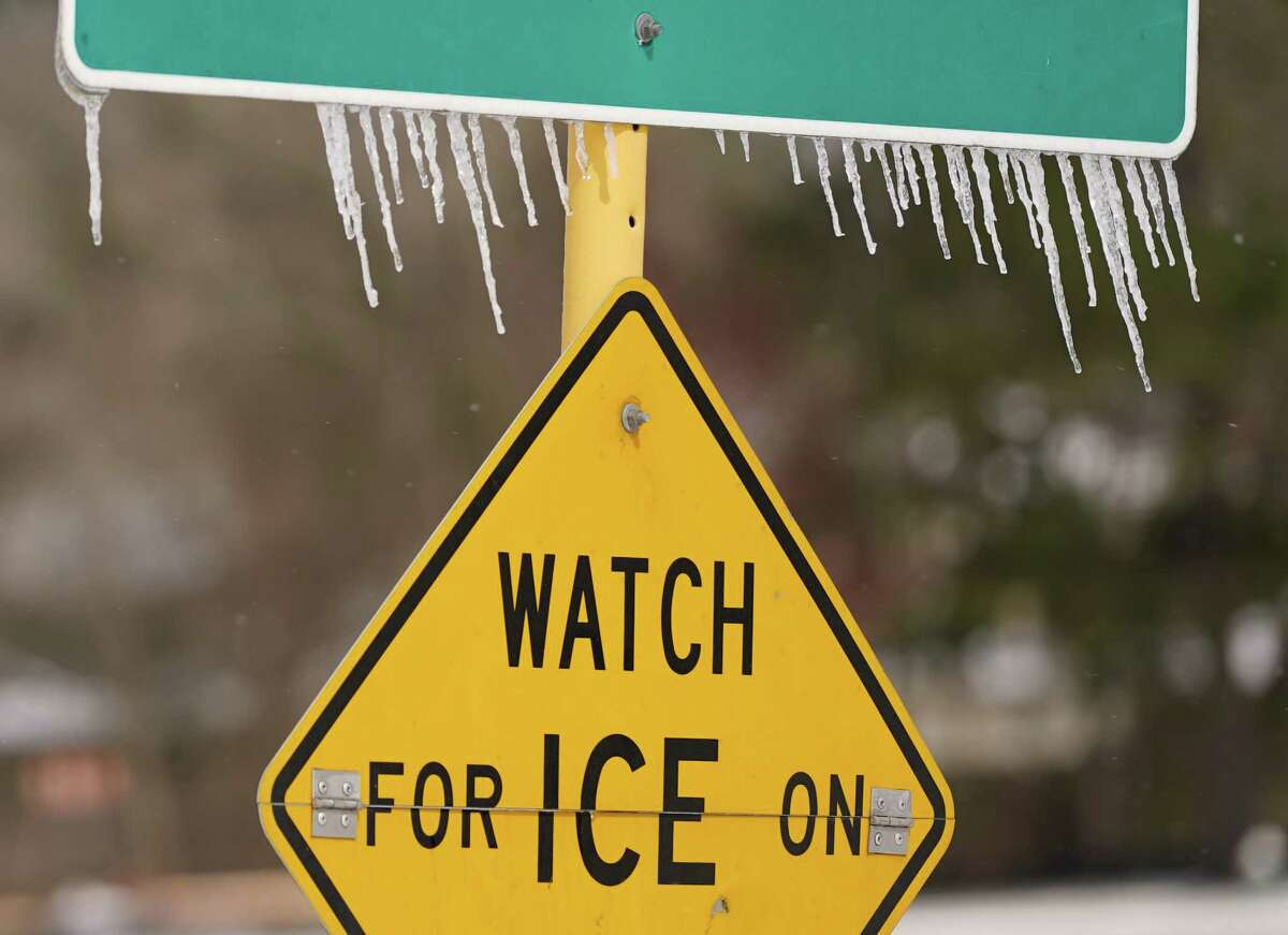 Icicles hang on a watch for ice on bridge road sign along Cutten Rd. near Bourgeois Rd. Monday, February 15, 2021 in Houston.