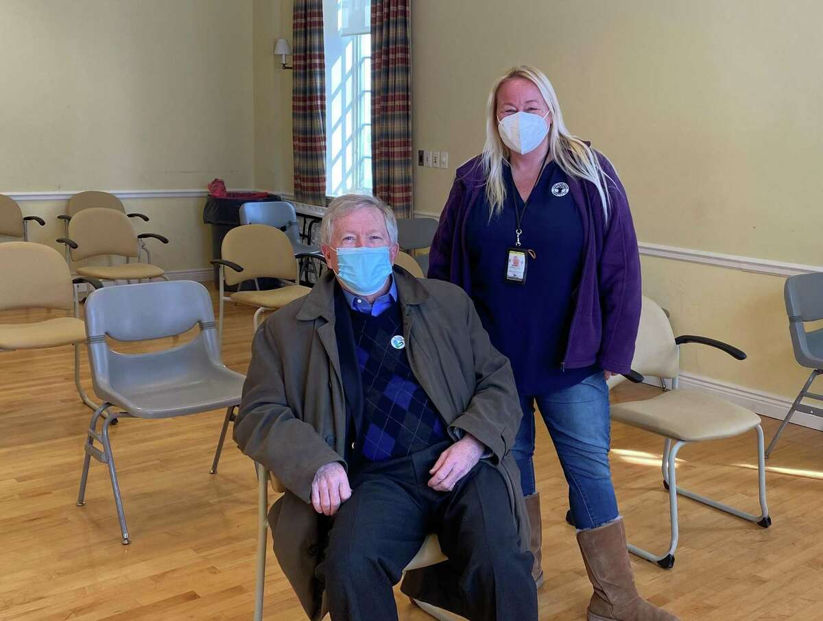 Director of Health Jenn Eielson stood behind First Selectman Kevin Moynihan shortly after he got vaccinated at the Lapham Center in Waveny Park, on Wednesday, Feb. 10.