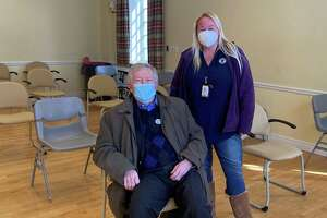Director of Health Jennifer Eielson, with First Selectman Kevin Moynihan, said residents have been extremely eager to schedule their COVID-19 vaccination appointments at the town's weekly clinic at Lapham Center in Waveny Park.