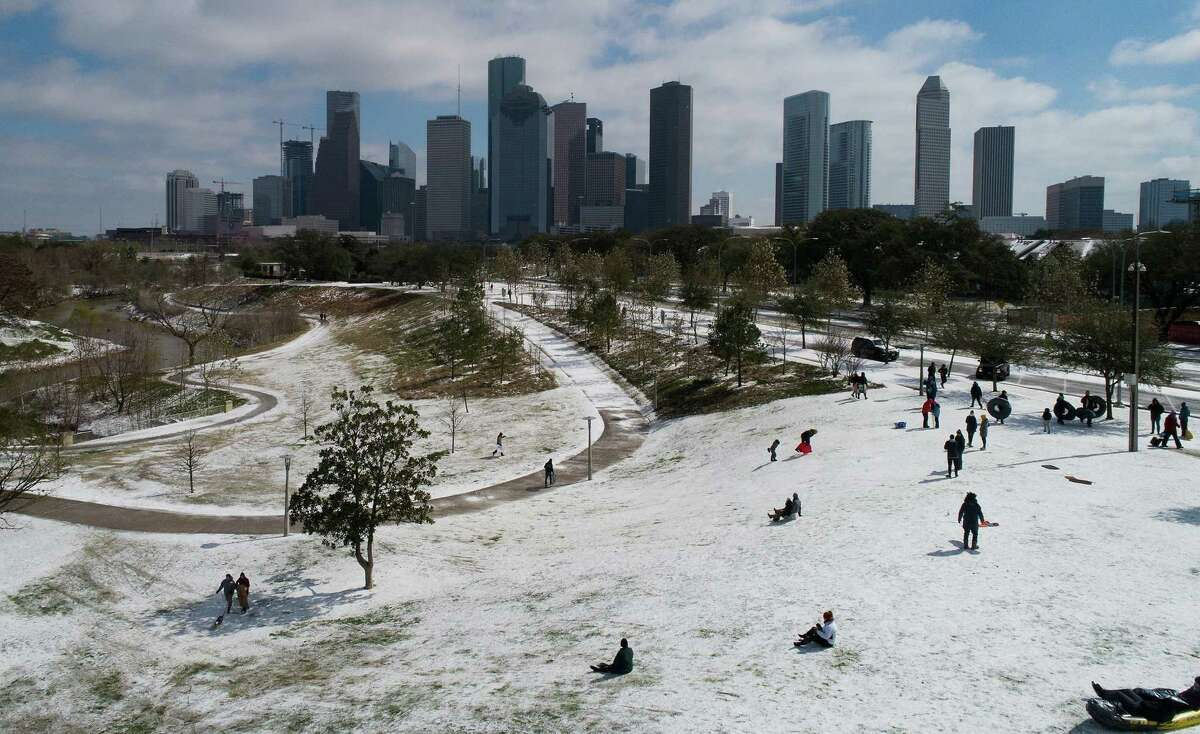 Here's something you don't see every day: People snow-sledding at Buffalo Bayou Park in Houston, Monday, Feb. 15, 2021.