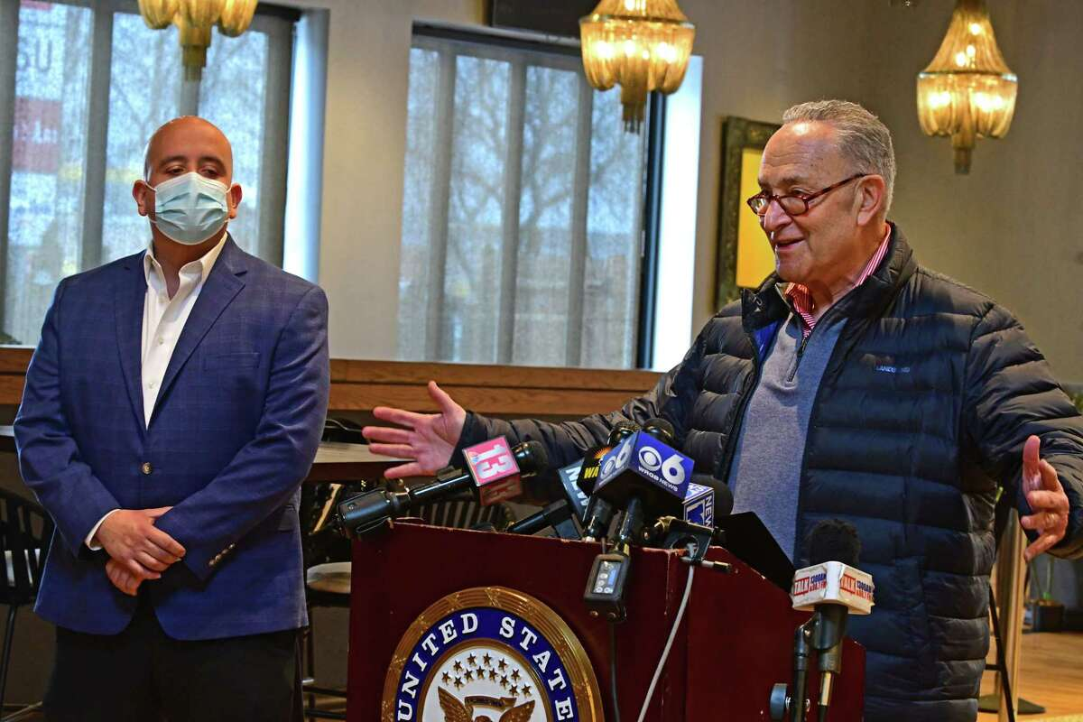 Jaime Ortiz, chef and co-owner of TORO Cantina, listens at left as Senate Majority Leader Charles Schumer unveils the new restaurant relief fund modeled on the widely supported bipartisan RESTAURANTS Act at TORO Cantina on Monday, Feb. 15, 2021 in Colonie, N.Y. (Lori Van Buren/Times Union)