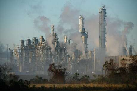 FILE -- Steam and fog rise from the Total refinery in Port Arthur, Texas on Dec. 21, 2020. The oil industry is slowly transitioning to a future dominated by cleaner energy. (Brandon Thibodeaux/The New York Times)