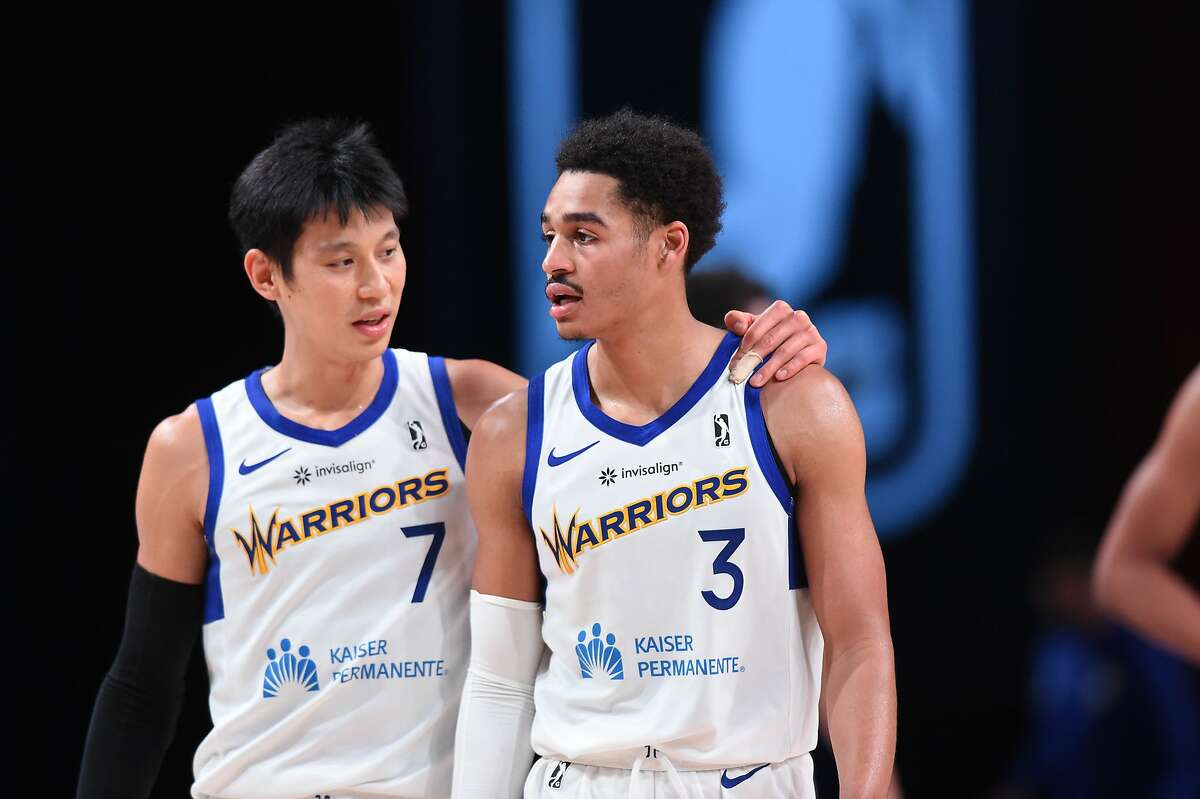 Jeremy Lin talks to fellow Santa Cruz Warriors guard Jordan Poole during a recent game at the G League bubble in Orlando.