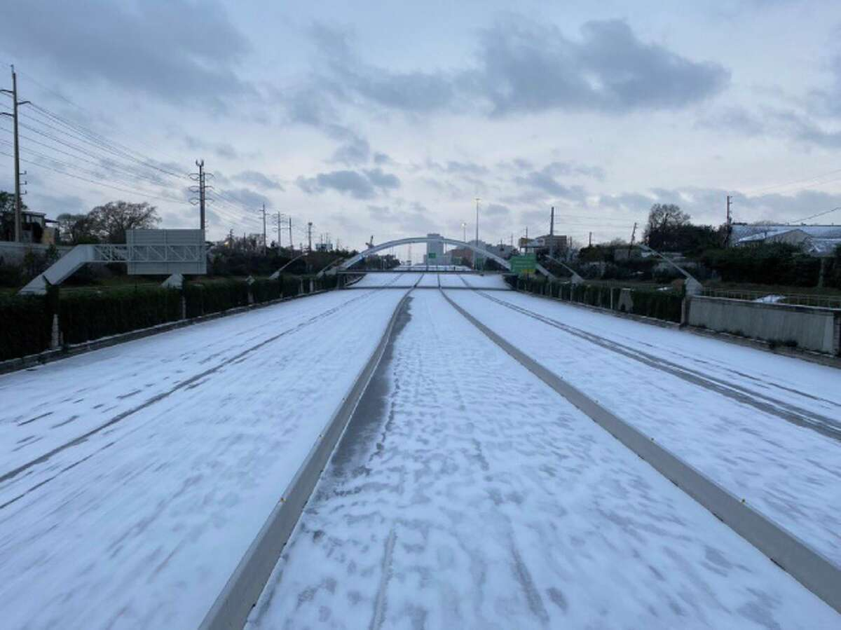Houston's Southwest Freeway covered in snow on Monday, February 15.