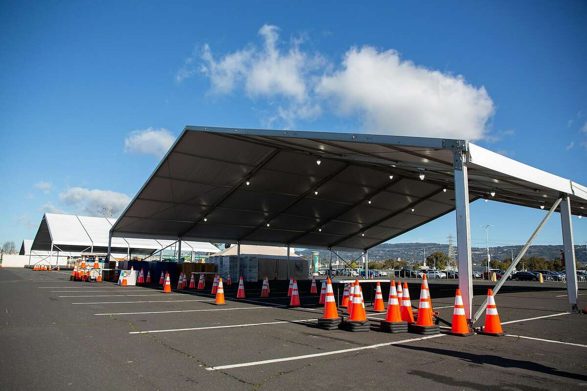 Large tents are set up for the drive-through portion of the mass vaccination site at the Oakland Coliseum on Friday.