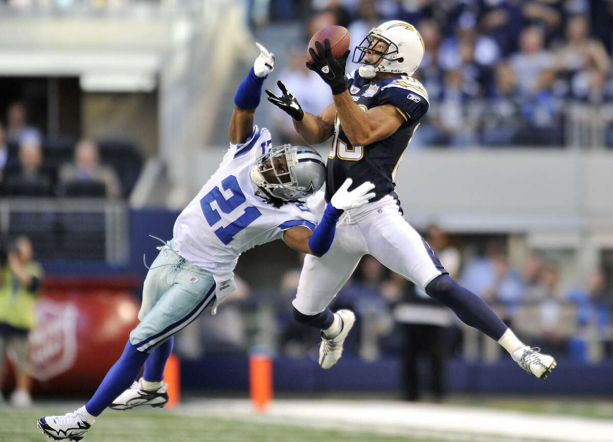 San Diego Chargers wide receiver Vincent Jackson, right, hauls in a pass for a reception as Dallas Cowboys cornerback Mike Jenkins (21) defends in the first half of an NFL football game, Sunday, Dec. 13, 2009 in Arlington, Texas. (AP Photo/Michael Thomas)