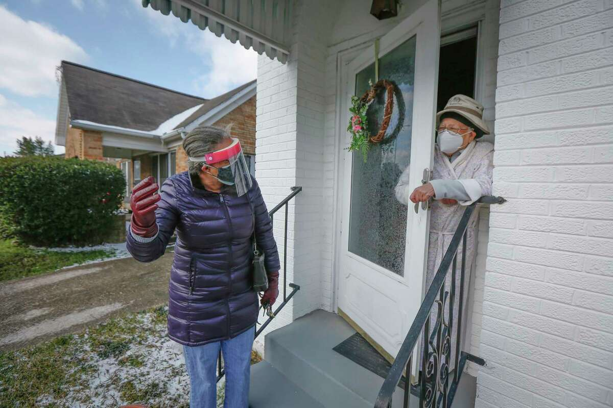 Linda Hollins checks on her friend Velma Williams during a power outage in Third Ward Monday, Feb. 15, 2021, in Houston.
