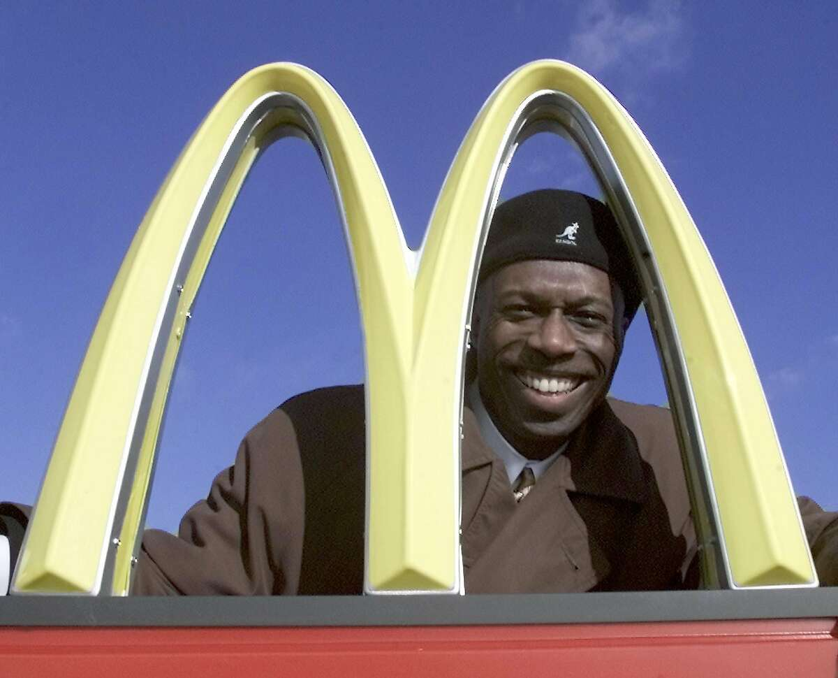 Former A's pinch-runner Herb Washington will claim in a lawsuit that McDonald's forced him to sell his franchises to white owners.