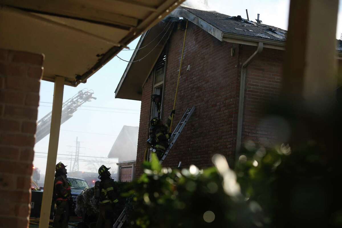 Houston firefighters respond to a fire that damaged at least three buildings at an apartment complex on the 6000 block of Bellaire Boulevard Monday, Feb. 15, 2021, in Houston. About 80 people were displaced, an HFD official said.