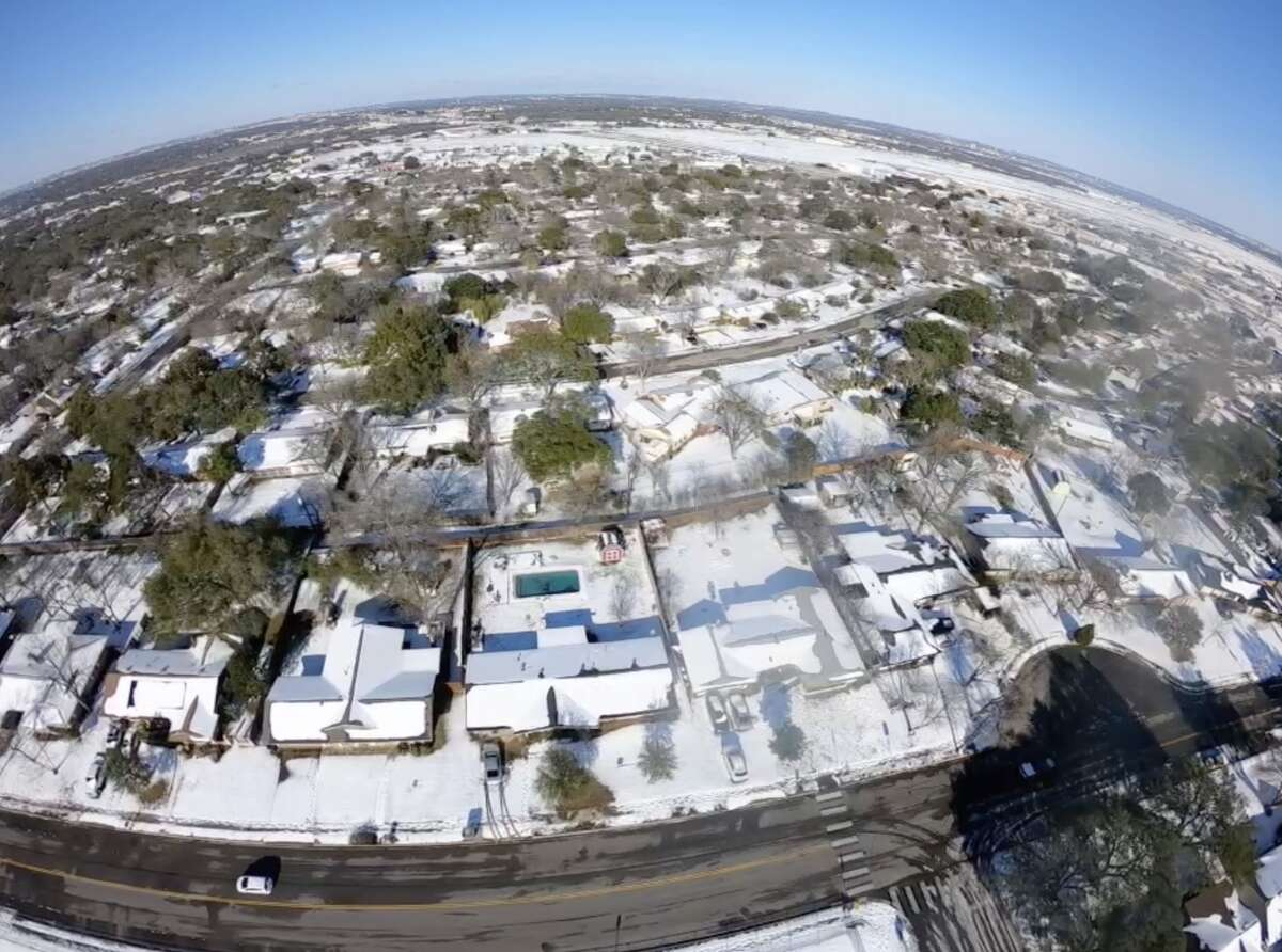 Drone footage of snow in San Antonio on Feb. 15, 2021. The winter weather has forced the closure of many stores across the city.