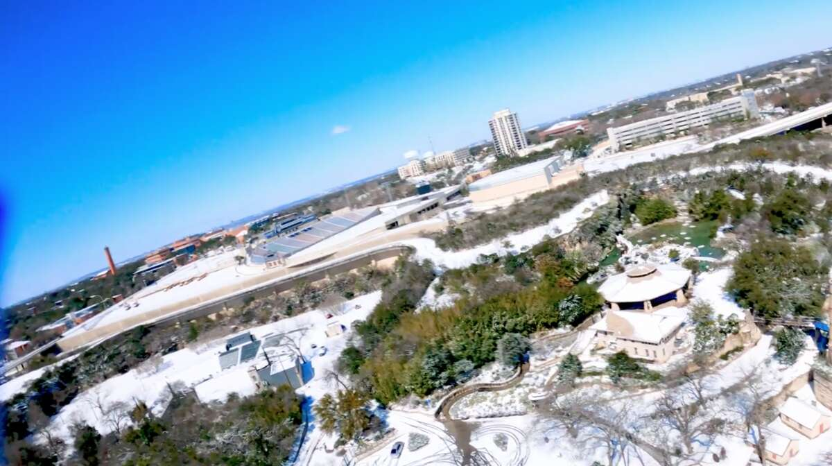 Parts of San Antonio covered in snow as seen from aerial footage.