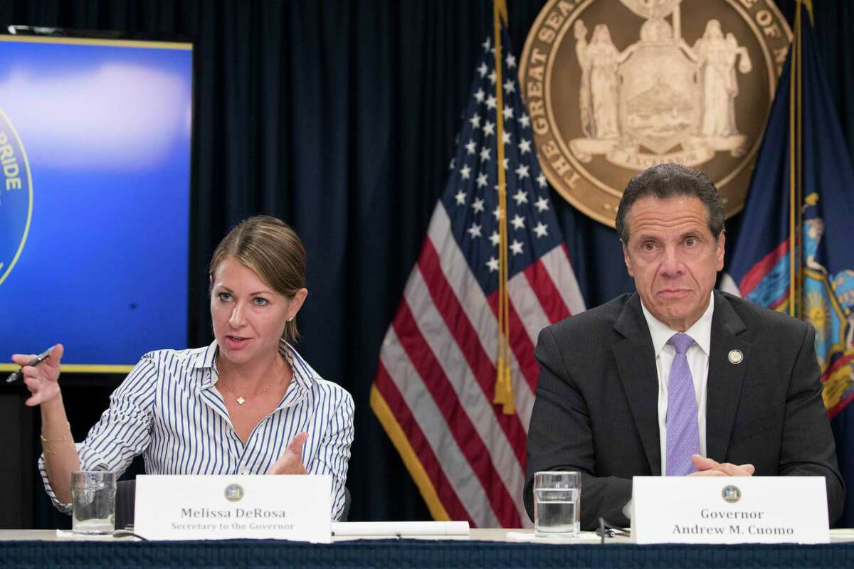"""FILE - In this Sept. 14, 2018 file photo, Secretary to the Governor Melissa DeRosa, is joined by New York Gov. Andrew Cuomo as she speaks to reporters during a news conference, in New York. De Rosa, Cuomo's top aide, told top Democrats frustrated with the administration's long-delayed release of data about nursing home deaths that the administration """"froze"""" over worries about what information was """"going to be used against us,"""" according to a Democratic lawmaker who attended the Wednesday, Feb. 10, 2021 meeting and a partial transcript provided by the governor's office. (AP Photo/Mary Altaffer, File)"""