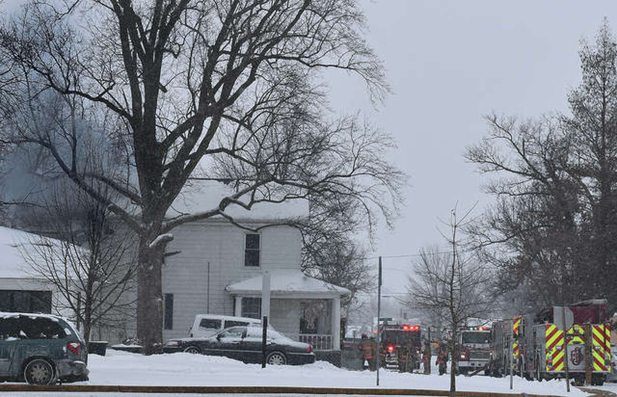 Jacksonville police and firefighters brave near-zero temperatures Monday to fight a fire in the attic of a house at 111 N. Kosciusko St. Emergency crews were on the scene for a couple of hours after the 11 a.m. call. The temperature at the time was 1 degree with a wind chill of about minus 16.