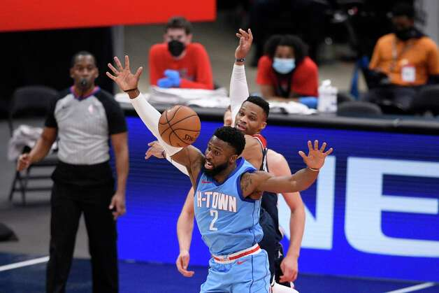 Houston Rockets guard David Nwaba (2) battles for the ball against Washington Wizards guard Russell Westbrook, back, during the first half of an NBA basketball game, Monday, Feb. 15, 2021, in Washington. (AP Photo/Nick Wass) Photo: Nick Wass, Associated Press / Copyright 2021 The Associated Press. All rights reserved