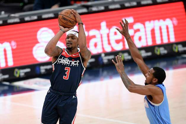 Washington Wizards guard Bradley Beal (3) shoots past Houston Rockets guard Sterling Brown, right, during the first half of an NBA basketball game, Monday, Feb. 15, 2021, in Washington. (AP Photo/Nick Wass) Photo: Nick Wass, Associated Press / Copyright 2021 The Associated Press. All rights reserved