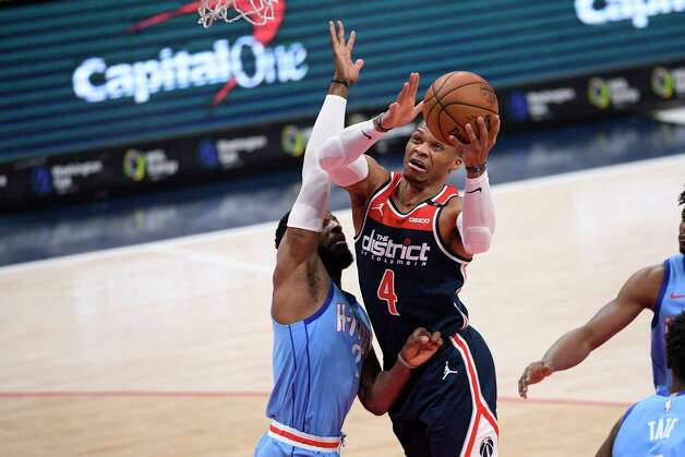 Washington Wizards guard Russell Westbrook (4) goes to the basket against Houston Rockets guard David Nwaba, left, during the first half of an NBA basketball game, Monday, Feb. 15, 2021, in Washington. (AP Photo/Nick Wass) Photo: Nick Wass, Associated Press / Copyright 2021 The Associated Press. All rights reserved