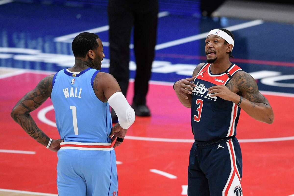 Former teammates John Wall and Bradley Beal chat during Wall's first game in Washington on Monday since he was traded to the Rockets.