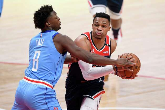Washington Wizards guard Russell Westbrook, right, drives to the basket against Houston Rockets forward Jae'Sean Tate (8) during the first half of an NBA basketball game, Monday, Feb. 15, 2021, in Washington. (AP Photo/Nick Wass) Photo: Nick Wass, Associated Press / Copyright 2021 The Associated Press. All rights reserved