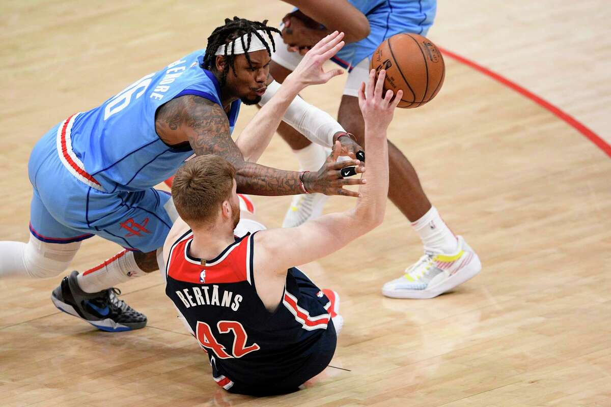 Houston Rockets guard Ben McLemore (16) battles for the ball against Washington Wizards forward Davis Bertans (42) during the second half of an NBA basketball game, Monday, Feb. 15, 2021, in Washington. (AP Photo/Nick Wass)