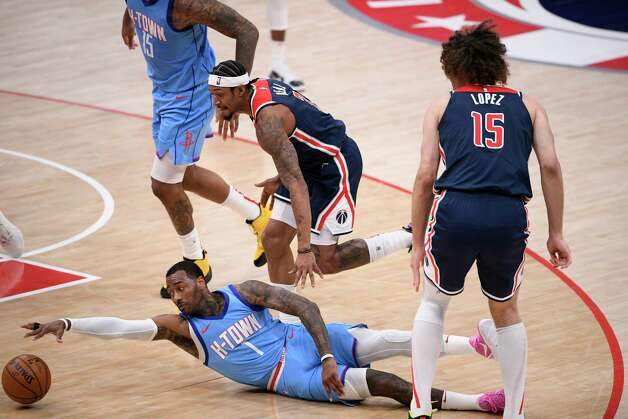 Houston Rockets guard John Wall (1) reaches for the ball after he was fouled by Washington Wizards center Robin Lopez, right, during the second half of an NBA basketball game, Monday, Feb. 15, 2021, in Washington. Also seen is Wizards guard Bradley Beal (3). (AP Photo/Nick Wass) Photo: Nick Wass, Associated Press / Copyright 2021 The Associated Press. All rights reserved