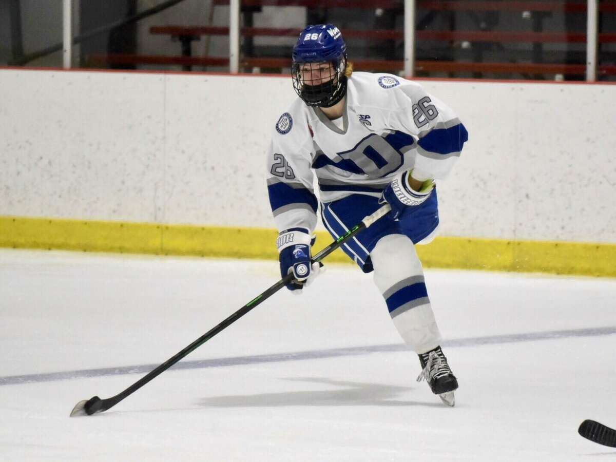 Darien's Luke Johnston (26) fires the puck into the zone during Monday's game against Notre Dame-West Haven.