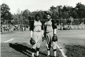 """Mohawk Giants first baseman Art """"Duck Soup"""" Milton and probably infielder Elmore """"Scrappy"""" Brown. On the field in the ball park in Central Park, Schenectady, NY."""